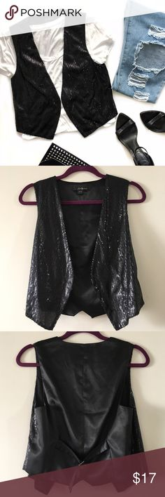 NWOT Black Open Sequin Vest This trendy black vest features an open front, black sequins on front, satin-back and adjustable back. NWOT. Shell: 100% polyester. Lining: 100% cotton. Contrast: 97% polyester, 3% spandex. On the bottom left part it is slightly pulled, barely noticeable (as shown in fourth picture). Forever 21 Jackets & Coats Vests