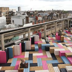 Studio Weave adds colourful herringbone decking to London College of Fashion roof garden.