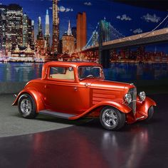 PALM BEACH AUCTION PREVIEW: Painted in Tangerine pearl paint with custom beige interior, this beautiful 1932 Ford 3-window coupe has an all-steel body. GM 454/450hp engine backed by a Turbo 400 automatic transmission. From the John Staluppi Cars of Dreams Collection.
