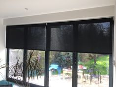 Roller Blinds in sunscreen fabric on BiFold doors