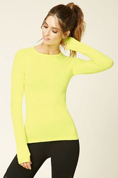 A stretch-knit seamless athletic top featuring a round neckline, long raglan sleeves, and moisture management.