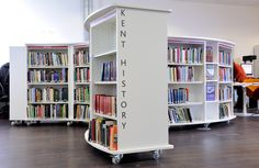Kent History and Library Centre | Demco Interiors - Inspiring Library Design: another example of curved shelving with wheels for flexibility. These would be more suited to the non-fiction collection in the Senior Library. Also liking the move away from metal shelving.