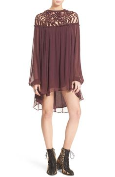 Romantic meets free-spirited with this bohemian style dress that includes a floaty silhouette and openwork macramé.