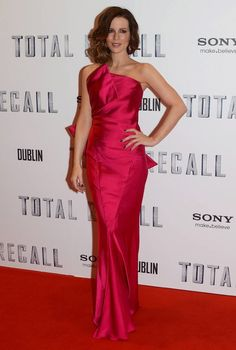 Kate Beckinsale looked stunning at the Total Recall Dublin premiere wearing this structured, fuchsia Donna Karan strapless column gown.    The gorgeous brunette teamed her look with sensational drop earrings, Jimmy Choo platforms and a beaded Judith Leiber clutch.    A wavy bob, a dark manicure and pink lip completed her glamorous look.