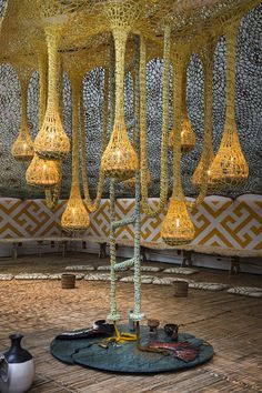 "Installation - ""NixiForestKupiXawa,"" 2015. Cotton, straw, paint, and wood Ernesto Neto,"