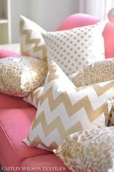 Pink couch and chevron pillows.