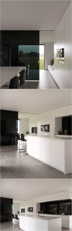 Modern white kitchen with a glass sliding door made from Dark Grey glass by Anyway Doors.