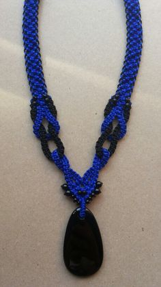 Beautiful and stylish Blue and black macrame necklace with black onyx..modren macrame is simple but nice and stylish..