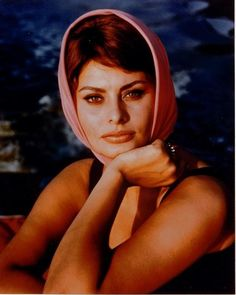 """""""A woman's dress should be like a barbed-wire fence: serving its purpose without obstructing the view.""""―Sophia Loren"""