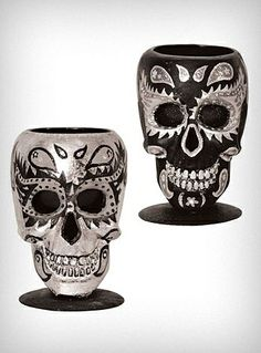 I reallly want the silver one! Sugar skull votive candle holders. Mmm dia di los muertos!