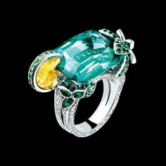 Piaget Limelight Mojito Cocktail Inspiration Ring in 18k white gold, set with a cushion-cut tourmaline (approx. 24.57 ct), a round citrine (approx. 3 ct), 8 marquise-cut emeralds (approx. 0.61 ct), 16 brilliant-cut tsavorites (approx. 1.56 ct), 120 brilliant-cut emeralds (approx. 1.01 ct) and 182 brilliant-cut diamonds (approx. 1.57 ct). $83,700