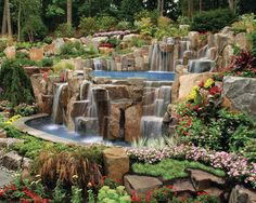 Surrounded by lush landscaping and rock waterfalls, this pool by Cipriano Custom Pools & Landscaping, Mahwah, New Jersey, is a beautiful spot to relax and unwind. http://www.luxurypools.com/articles/natures-balance.aspx#