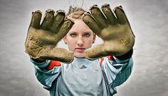 Cool picture for the Goalie, like how the gloves look worn and her face is in focus.