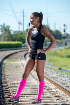 Neon Pink Compression Socks - Get the look at http://www.brightlifego.com/zensah-compression-socks.html  I just like her bod...:P