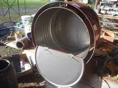 Building first white, low mass insulated barrel rocket oven – Appropriate-Tech Workshops Fiberglass Insulation, Fire Cooking, Dishwashing Liquid, Stove Oven, Rocket Stoves, Metal Working, Drums, Barrel, Workshop