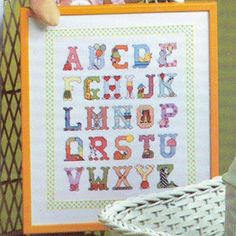 """Baby Alphabet Sampler Cross Stitch ePattern - Number of Designs: 1 Approximate Design Size: Stitch Count: 190w x 232h Approximate Design Size: 10 5/8""""w x 13""""h (when stitched on 18 count fabric) Designer: Rachel Crissinger Original Publication: Leisure Arts Leaflet #158, Charted Designs For Your Baby † Description: Stitch your favorite word or the entire sampler to create a sweet home decor addition to a special baby's room. Our design was stitched on White Aida (18 ct) and custom ..."""