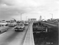 LOS ANGELES - DOWNTOWN: Hollywood 101 Freeway near downtown L.A. City Hall is visible in the background, ca. early 1950's.