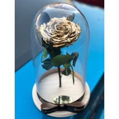 Gorgeous dome with gold eternal rose . Delivery worldwide! Contact us: contact@buchetino.com .   The rose is eternal and we guarantee that the rose will last for at least 3 years.