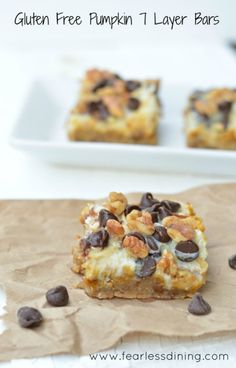 Gluten-Free 7-Layer Bars (Magic Cookie Bars). Pumpkin 7-Layer Bars shown. [featured on GlutenFreeEasily.com] (photo)