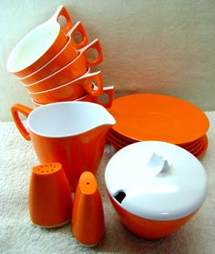 Orange Ornamin Ware Table Set - Cups and Saucers, Creamer, Sugar Bowl, Salt and Pepper Shakers