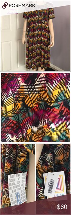 LuLaRoe Carly ~ HTF Print 🦄 LuLaRoe Carly  Rare & Hard to Find Gorgeous Colors with an Awesome Print! Brand New with Tags Attached  Leggings Material  Front Pockets Gorgeous Mix of Rich Colors Pair this up with a Joy or Sarah and a pair of Boots & you have the Perfect Fall Outfit! ✅ Price is Firm unless Bundled LuLaRoe Dresses High Low