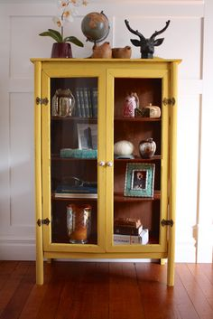 Bright, Bold, and Beautiful DIY mustard yellow storage cabinet brought to life with paint. | blog.countrychicpaint.com