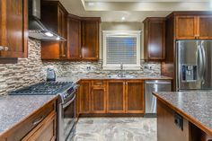 Excalibur Custom Home | Nanaimo | Ridgeview Place -  custom cabinetry, horizontal glass tile backsplash