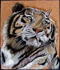 This is a handmade marble mosaic that is composed of all natural stones and hand cut tiles. It shows a white tiger. White Tigers are one of the most majestic and rarest animals on earth. They are the absolute symbol of power, ferocity, beauty and grace.