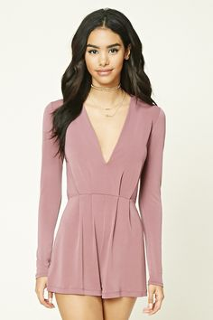 A stretch-knit romper featuring a pleated front, deep V-neckline, long sleeves, and an elasticized waist.