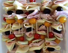 i like the idea of sandwich skewers - cucumbers, olives, ham, cheese, cherry tomatoes.