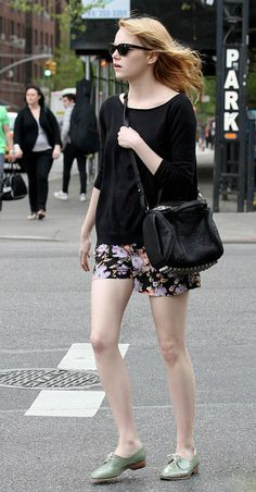 Emma Stone carrying Alexander Wang Pre-Fall 2012 rockie in black leather with antique brass , also, i love her shoes!