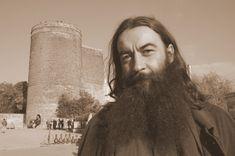 Artist in front of maiden tower Baku