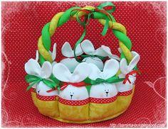 Como fazer cesta de páscoa em tecido passo a passo com coelhinhos de pano paracolocar ovos de páscoa. Neste passo a passo iremos aprender como fazer uma l