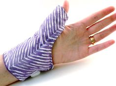Rice Heating Pad for Thumb, Mcrowaveable Thumb Wrap, Hot Cold Therapy Rice Bag. $24.95 on Esty