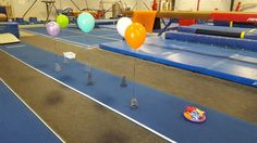 Preschool Gymnastics: Run thru the balloon maze and toss the bean bag in the tray.