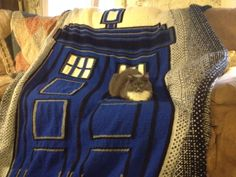 TARDIS afghan. My stepmother is almost finished with it. Her cat is giving perspective on the size. Pattern comes from Carrie Fritsche on Ravelry: http://www.ravelry.com/patterns/library/doctor-who-tardis-afghan