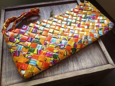 Rubbish Bags! Recycled clutch bag, handwoven from waste juice cartons by skilled female Fair Trade artisans.
