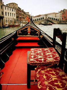 Gondola rides approaching the Rialto Bridge where a kiss means you will find forever love on the canals of Venice, Italy