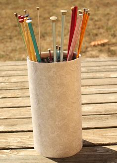 Knitting Needle Storage - oatmeal container, scrapbook paper, and yarn (yarn for the grid to organize needles inside)