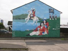 Loyalist mural of King William of Orange defeating King James II at the Boyne, Shankill Road, Belfast, Northern Ireland