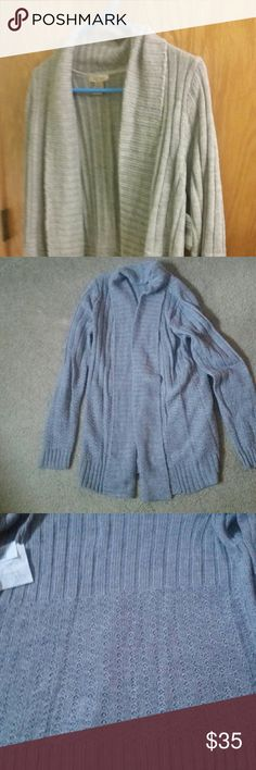 """Brand New Sweater The sweater is new with tags. The color is heather gray. Its a size medium,  but would fit a large too. Made of acrylic, and it is nice and soft. From color down uts 29.50"""" long. And sleeves from shoulder down is 26"""" long. Would look great, with almost anything. FRESH Sweaters Shrugs & Ponchos"""