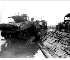 A Sherman tank hitching a ride on a Higgins boat.