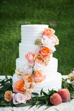 Garnish your wedding cake with a cascading line of roses and stock, plus peaches for a fresh accent. A garden wedding delight! {Photo by Shelly Taylor Photography, cake by Lily's Cakes}