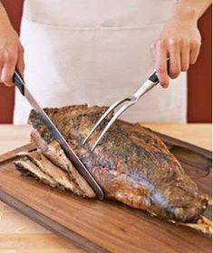 A leg of lamb on a cutting board