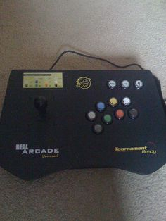 """This is the arcade stick that I'll be using for my new custom arcade stick project. It's an old Pelican """"Tournament Ready"""" stick for PS2/Xbox/GameCube. I'm going to gut it and use my own internal hardware for the best compatibility with multiple cons   Video Game Systems  Information."""