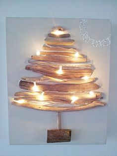 A stunningly unique take on the traditional Christmas tree. Driftwood Christmas Decorations, Driftwood Christmas Tree, Winter Christmas, Christmas Holidays, Happy Holidays, Christmas Tree Canvas, Xmas Trees, Xmas Crafts, Diy Crafts