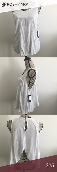 NWT guess tank w/ open back NWT so never worn in size Large. White with off white detail and also has an open back and keyhole detail in the back Guess Tops Tank Tops