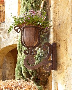 """$350 Madrigal Wall Planter at Neiman Marcus. 18""""W x 22.25""""D x 24""""T."""