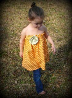 girl's tangerine tube tunic with lime rosette