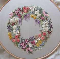 Available on pale green or cream dupion silk, linen/cotton blend or on 100% cream cotton. RECENTLY RE-STITCHED! This lovely design was created for those who have done some silk ribbon embroidery and wish to go that next step further. Design measures 7 inches or 17cm in diameter. Kit #silkribbonembroidery